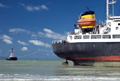 ship with tug boat
